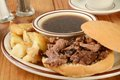 Roast beef au jus a sandwich with home fried potatoes Royalty Free Stock Photography