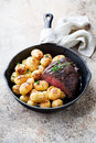 Roast beef and baked potatoes Royalty Free Stock Photo