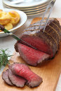 Roast beef carving sunday dinner Royalty Free Stock Image