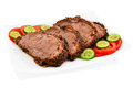 Roast beef delicious with tomatoes and cucumbers on a plate Royalty Free Stock Photos
