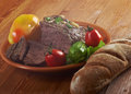 Roast beef farm style with vegetable and bread farmhouse kitchen Stock Photo