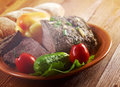 Roast beef farm style with vegetable and bread farmhouse kitchen Royalty Free Stock Photos