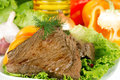 Roast beef on lettuce leaves with vegetables Stock Photography