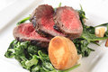 Roast beef  and sauteed spinach Royalty Free Stock Photography
