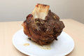 Roast beef shin on the white plate Royalty Free Stock Photography