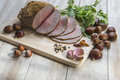 Roast beef sliced with some ingredients on the table of the kitchen Royalty Free Stock Image
