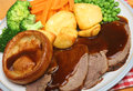 Roast beef sunday dinner with yorkshire pudding vegetables and gravy Stock Image