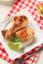 Roast chicken drumsticks Stock Images