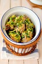 Roast chicken drumsticks topped with lemon garlic and parsley relish Stock Images