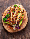 Roast Chicken filet kebab on bamboo sticks Royalty Free Stock Photo