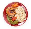 Roast chicken mediterranean style roasted with tomatoes and long sweet peppers and served with a pilaf Stock Photo