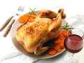 Roast chicken and prepared carrots on plate Royalty Free Stock Images