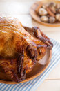 Roast chicken ready to eat on dining table Stock Image