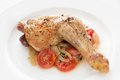 Roast chicken with tomatoes, onions and herbs Royalty Free Stock Photo