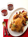 Roast chicken and two glasses of red wine Stock Photography