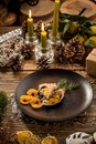 Roast Christmas duck with orange on wooden table on decorated christmas background