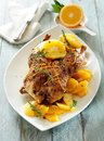 Roast duck with oranges and herbs.