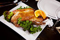 Roast duck with orange and parsley