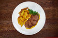 Roast fillet beef with potatoes shallow depth of field Stock Photography