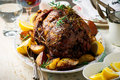 Roast lamb leg with Vegetables.style rustic. Royalty Free Stock Photo