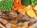 Roast lamb sunday dinner with mint sauce Stock Image