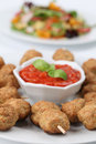 Roast meatballs on skewers and tomato dip Royalty Free Stock Photos