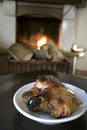 Roast piglet in front the fireside Royalty Free Stock Photo