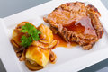 Roast pork with gravy and potatoes Stock Image