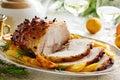 Roast pork with orange glaze decorated cloves Royalty Free Stock Image