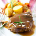 Roast pork with sauce Royalty Free Stock Images