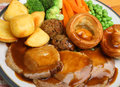 Roast pork sunday dinner with vegetables and gravy Royalty Free Stock Images