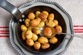 Roast potatoes pan full of crispy golden brown with serving spoon Stock Photography