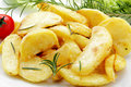 Roast potatoes with rosemary Stock Photo