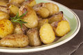 Roast potatoes with rosemary a platter of new Stock Photos