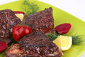 Roast rib's on green dish Royalty Free Stock Photo