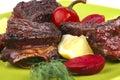 Roast rib's on green dish Royalty Free Stock Photo