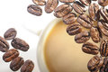 Roasted arabica coffee beans on the glass under drink Royalty Free Stock Image