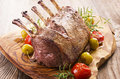 Roasted back of venison as closeup on a wooden cutting board Royalty Free Stock Images