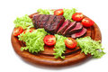 Roasted beef meat steak on wooden plate Stock Photos