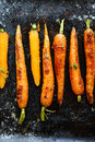 Roasted carrots with spices on a baking tray food Royalty Free Stock Photos