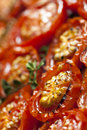 Roasted cherry tomatoes with thyme soft focus Royalty Free Stock Photos