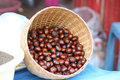 Roasted chestnuts in bamboo basket Royalty Free Stock Photo