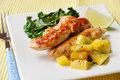 Roasted chicken breast with saute kale and squash vegetables small portion of leafs garnish lime selective focus shallow dof Stock Photo