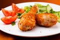 Roasted chicken drumsticks legs and vegetables Royalty Free Stock Photos
