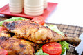 Roasted chicken drumsticks and vegetables Stock Photography