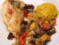 Roasted chicken leg with vegetables closeup of a and rice Royalty Free Stock Image