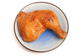 Roasted chicken leg on white background Royalty Free Stock Images