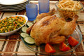 Roasted chicken ready to serve table side fries ensalada rusa Royalty Free Stock Photo