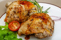 Roasted chicken thighs with herbs and spices Stock Photos