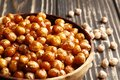stock image of  Roasted chickpeas in a bowl on a wooden background